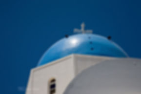 Details of the roof of a greek white and blue church, on the greek island of Santorini.