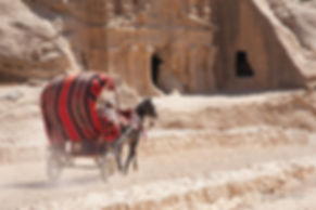 Photograph of the entrance of he ancient site of Petra in Jordan.