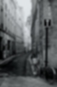 Fine Art black and white photography. A narrow street in the old part of the city of Bordeaux, France.