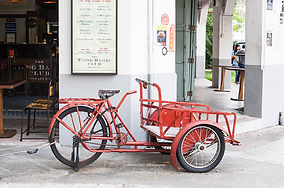 Photograph of a red cart in the streets of Singapore
