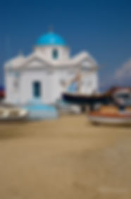 Photograph of a church on the beach in te greek island of Mykonoss.