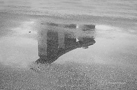 Black and white picture of the reflection of the Marina Bay Sand hotel in the water, Singapore