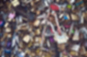 Close-up photograph on the thousands of lockers symbol of love, on Paris bridges.