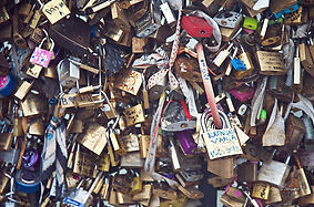 Close-up photograph on the thousands of lockers symbol of love, on Paris bridges.