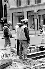 Fine Art black and white photography. Workers in the street of New York, USA.