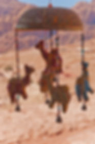 Photograph of an handmade baby mobile with tiny camels and bells, made and sold in Petra, Jordan.