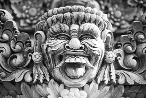 Black and white photograph of the detals of a stone sculture in Ubud, Bali.