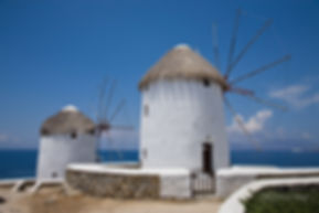 Photograph of the iconic mindwills of greek island of Mykonos.