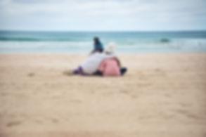 Sisters hugging in Manly beach, Sydney, Australia.
