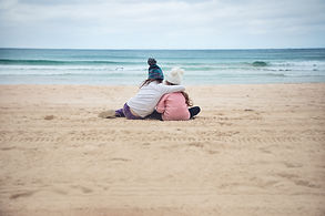 Sisters hugging in Manly beach, Sydney, Australia.
