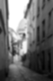 Fine Art black and white photography. A narrow street leading to the Sacré Coeur church, in Montmartre, Paris, France.
