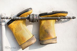 A pair of yellow rubber boots.