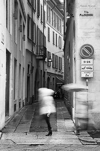 Black and white street photography in Milan, Italy.
