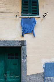 Details of a wall, and hanging laundry, in Riomaggiore, Cinque terre, Italy.