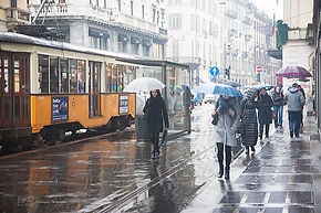 Commuters walking under the rain in Milan,Italy.