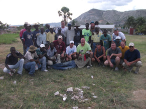 2011-07 mission team & Hatian workers.JP