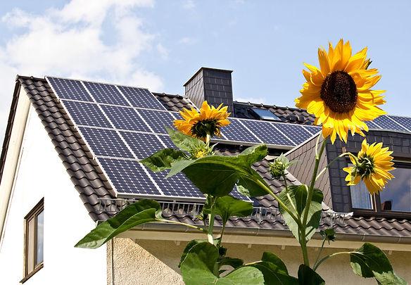 Solar-on-a-roof-with-sun.jpg