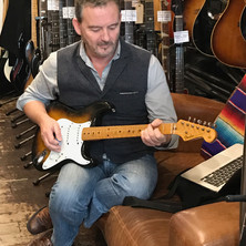 With a 1955 Fender Stratocaster