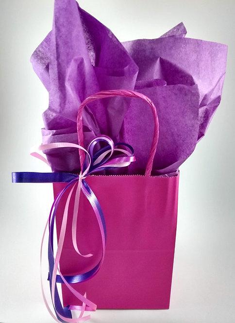 Emballage cadeau (sac rose, papier mauve, boucle)