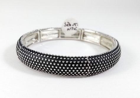 Bracelet Spoutnik élastique, Bande courbe métal argent, texture pois, fond noir