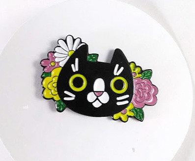 Épinglette: Chat avec fleur