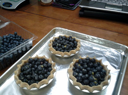 Preparing Small Blueberry Pies