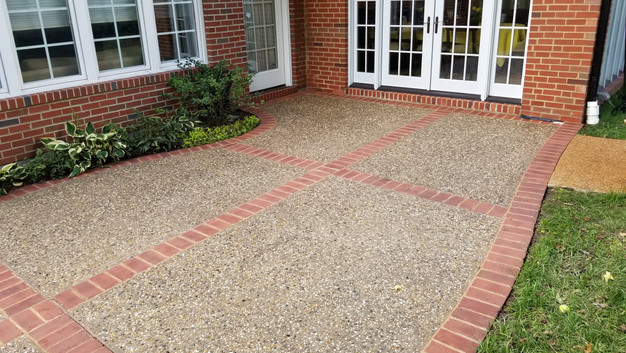Exposed Aggregate Patio With Brick Header