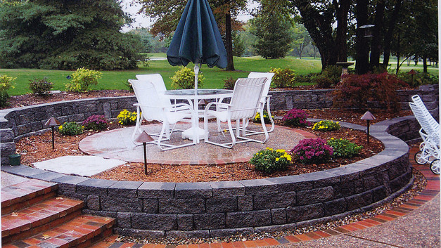Exposed Aggregate Patio with Stone Wall