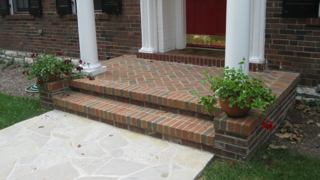 Brick Front Porch with Stone Walkway