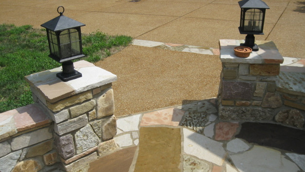 Exposed Aggregate Concrete Driveway with Stone Header