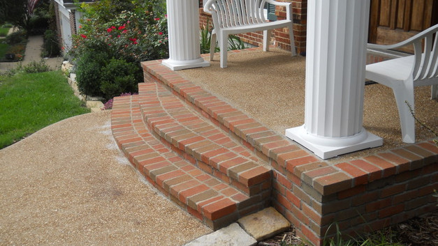 Exposed Aggregate Front Porch with Brick Wall and Steps
