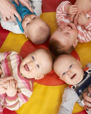 Overhead View Of Babies Having Fun At Nu