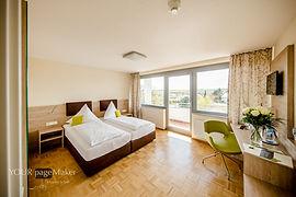 Doppelzimmer Comfort+ und Dreibettzimmer