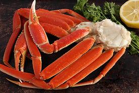 Crab legs on brown rustic background.jpg
