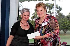 Carmel Slater presents cheque to Rotary Leongatha