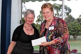 Carmel Slater presents cheque to Rotary Leongatha