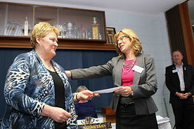 President Shirley presenting Christine Williams with a donation.