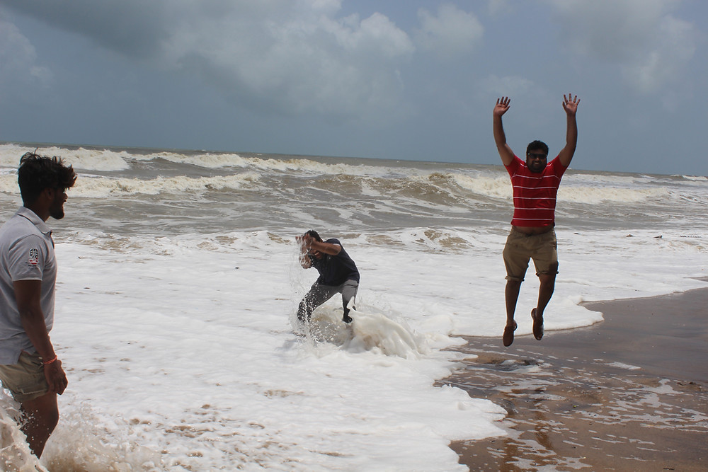 friends having fun at the beach in Goa