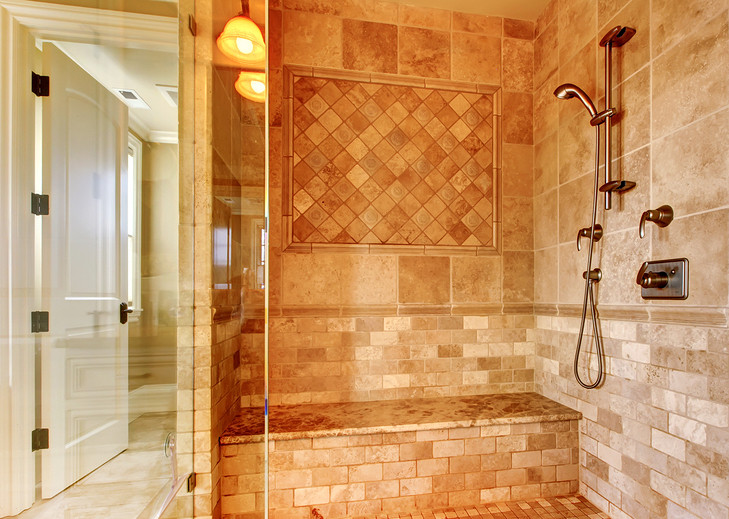 tile shower with frameless glass and shower bench