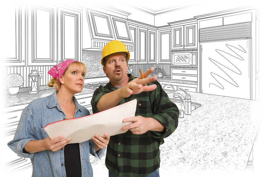 kitchen remodel contractor standing with homeowner review kitchen design