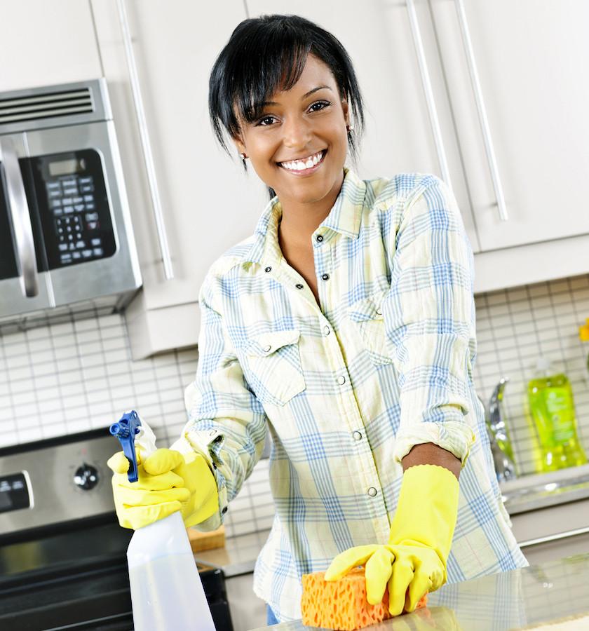 woman sealing granite countertops