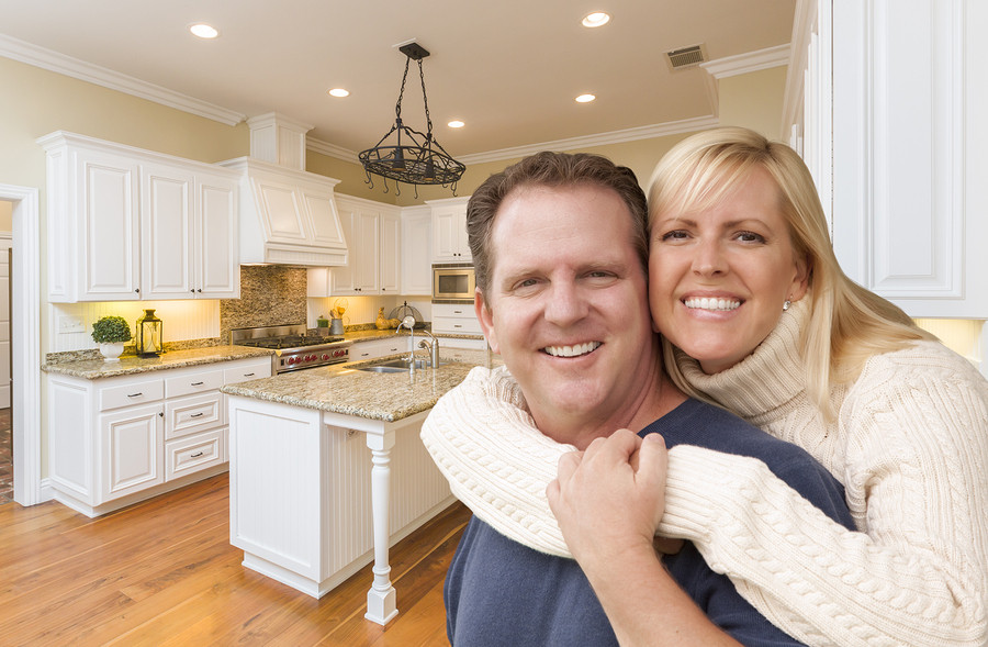 man and woman standing in newly remodeled kitchen