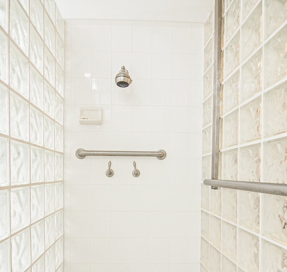 tile shower wall in bathroom