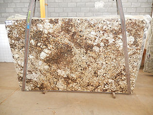 Large granite slab with orange and white speckles
