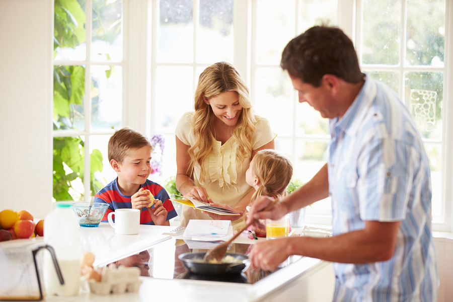 family making dinner in remodeled kitchen