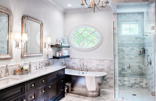large bathroom with oval mirror and frmeless glass shower
