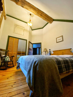 Vaulted ceilings of the second floor bedroom with queen bed