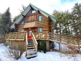 Front of Towering Pines Cottage in the winter