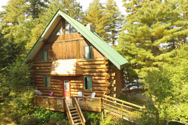 Front of Towering Pines Cottage in the summer