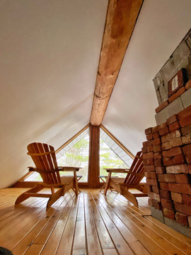 Two Muskoka chairs in the loft
